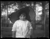 Unidentified little girl wearing a woman's hat, Chance, Maryland, undated (ca. 1919-1920).