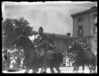 Soldiers riding horses in a parade for the Army's 29th Division, Baltimore, Maryland, undated (ca. 1919).
