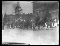 Soldiers from the Army's 29th Division leading horses pulling caissons, Baltimore, Maryland, undated (ca. 1919).