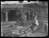 Unidentified civilians examining a large artillery piece mounted on a train car, Baltimore, Maryland, undated (ca. 1919).