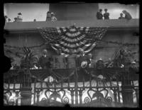 Unidentified military and civilian officials on a reviewing stand with Mayor of Baltimore William F. Broening (right), Baltimore, Maryland, undated (ca. 1919).