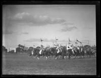 Unidentified mounted military drill or demonstration with men on horseback in Middle Eastern dress, undated (ca. 1930-1935).
