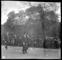 Unidentified officials walking in a parade, undated (ca. 1905-1909).
