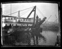 Dredge on the Harlem River at 136th St., New York City, undated (ca. 1905-1915).