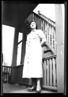 Odessa France Bjorkman standing on the porch of an unidentified house, probably Yonkers, N.Y., undated (ca. 1940-1945).