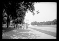 Group of Boy Scouts walking on the Mall with the Capitol building in the background, Washington, D.C., undated (ca. 1937). Probably during the 1937 Boy Scouts' National Jamboree.
