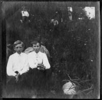 Fritz Bjorkman and an unidentified boy sitting on a rock, undated (ca. 1905-1909).