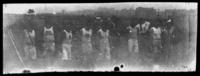 Unidentified young men in athletic clothes on a playing field, undated (ca. 1905-1915).