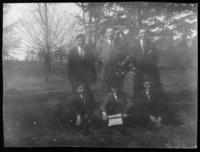 Group of unidentified young men posing in field, undated (ca. 1910-1915).