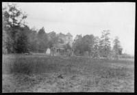 Unidentified house surrounded by woods and fields, undated (ca. 1900-1909).