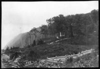 Unidentified house on a hill behind trees, undated (ca. 1900-1909).