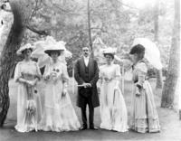 Alice Roosevelt with the wives of the Ambassador and 1st Secretary of the American Legation, Mrs. Francis G. Newlands, and an unidentified official at a garden party at the American Embassy in Tokyo, Japan, undated [1905].
