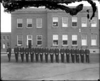 Unidentified men in uniform lined up for review, location unknown, undated [circa 1900-1910].