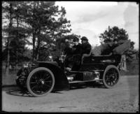 A.E. Gallatin and unidentified companion in an open-topped automobile, undated [circa 1900-1910].