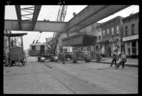 Fifth Avenue El, Brooklyn, at 18th Street, September 26, 1941. Carting girders away.