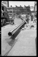 Fulton Street El, Brooklyn, June 27, 1941. Cutting up a column from the canopy of the Orpheum Theater.