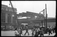 Fulton Street El, Brooklyn, at Hudson Avenue, July 1, 1941. View showing the last girders spanning the Fifth Avenue line.