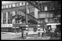 Fulton Street El, Brooklyn, at Hudson Avenue, July 1, 1941. Taking down the first 15 ton section.