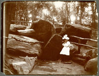 Unidentified girl drinking at Montaigne's Spring, McGown's Pass, Central Park, New York City, July 23, 1898.
