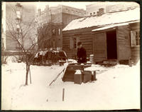Unidentified man at a well in the vicinity of 62 W. 115th Street, on the south side near Lenox Avenue, New York City, December 27, 1897.