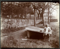 Unidentified boy at a well on the Hudson River shore at W. 158th Street, New York City, May 13, 1898.
