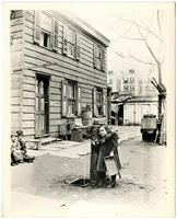 Unidentified girl at the water pump at the rear of 65 E. 87th Street, north side between Madison and Park, New York City, April 21, 1898.