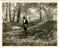Unidentified man beside a forest well in Inwood that formerly supplied the McCreery house, New York City, June 9, 1898.