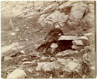 Unidentified boy at a spring located between Sedgwick Avenue and Lind Avenue at about W. 165th Street, Bronx, New York, December 6, 1899.