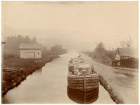 Flat boat on an unidentified canal, undated [c. 1897-1902].