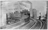 A southbound Sixth Avenue El train rounding the curve with Church Street from Murray Street in Manhattan, undated [c. 1880-1900]. Copy photograph dated May 24, 1940.