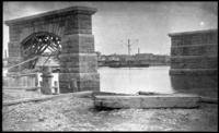 El bridge supports in the Harlem River just east of Second Avenue, 1883 or 1884. Intended for the Suburban Rapid Transit Company's Bronx El.