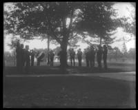 Band playing under trees, Fort Slocum, New York, 1898.