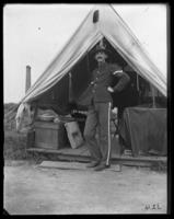 Corporal William S. Crewe at his tent, Fort Slocum, New York, 1898.