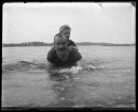 Lieutenant-Colonel Nathaniel Blunt Thurston swimming with Tuppie on his back, Fort Slocum, New York, 1898.