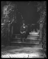 Army doctor sitting on the steps of HQ, Fort Slocum, New York, 1898.
