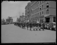 "Elderly men marching with a banner, ""Morrisania Exempts,"" Decoration Day, Bronx, N.Y., 1903 or 1909."