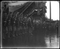 "Men with rifles under banner ""North Side Board of Trade,"" Decoration Day, Bronx, N.Y., 1903 or 1909."
