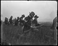 Reloading rifles, sham battle, [possibly Van Cortlandt Park, Bronx, N.Y.], June 15, 1901.