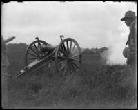 Gun firing, sham battle, [possibly Van Cortlandt Park, Bronx, N.Y.], June 15, 1901.