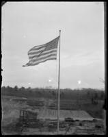 American flag flying over the construction site, Croton Dam strike, Croton Landing, N.Y., April 21, 1900.