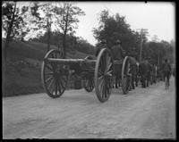 The Second Battery transporting guns down Albany Road, Bronx, N.Y., 1899.