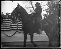 Captain [i.e. Brevet Major David] Wilson of the 2nd Battery N.G.N.Y. passing the reviewing stand during the parade to the new armory, Bronx, N.Y., October 25, 1902.