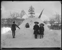 Children in front of their snow house, Bronx, N.Y., February 1905.