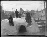 Children on top of their snow house, Bronx, N.Y., February 1905.