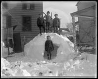 Children in front of the remains of a snow house, Bronx, N.Y., February 1905.