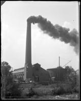 Unidentified factory with active smokestack, Bronx, N.Y. [?], undated.