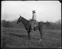 Unidentified man on horseback, New York Zoological Gardens [the Bronx Zoo], Bronx, N.Y., 1899.