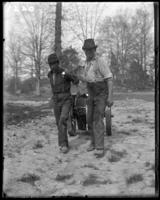 Two men pulling a cart, New York Zoological Gardens [the Bronx Zoo], Bronx, N.Y., 1899.