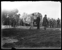 Officials visiting the Rocking Stone, New York Zoological Gardens [the Bronx Zoo], Bronx, N.Y., 1899.
