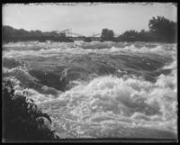 Rapids, with the Goat Island Bridge [?] in the background, Niagara Falls, undated [c. 1899-1904].
